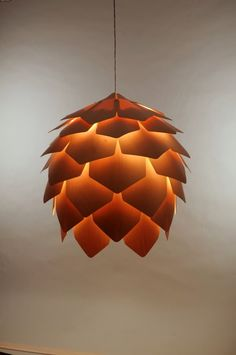 """Crimean Pinecone Lamp is a wooden pendant light designed by Russian designer Pavel Eekra. In designer's words, """"Crimean pinecone lamp consists of 56 Pendant Lamp, Pendant Lighting, Ceiling Lighting, Ceiling Pendant, Bedroom Lighting, Hanging Lamp Design, Hanging Lamps, Woodland Room, Woodland Theme"""