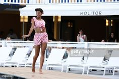 A model walks the runway wearing a 1960's french swimsuit during the Bikini Restrospective at Piscine Molitor on July 5, 2015 in Paris, France.