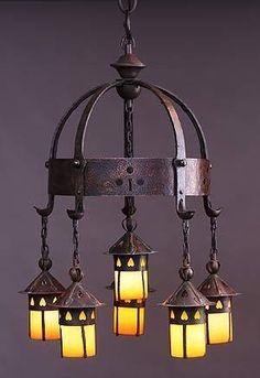 Gustav Stickley, (Five-light) electrolier No.  233 designed c.  1904.  Iron, copper, glass.  Crab Tree Farm.                Newark Museu