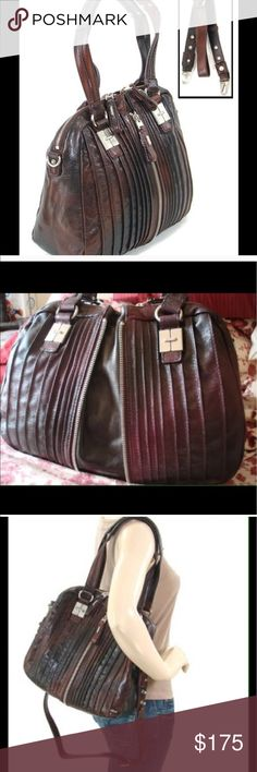 """🎀TULAH Ray Split Satchel Like New!!🎀 This bag is both practical and biker chic looking in EUC! Pleated gradient paprika leather with Matte silver hardware free of any scratches. Am only selling due to unforeseen circumstances😔It has a middle zipper that enlarges the bag as well as a top zippered closure. Striped lined interior, clean, w/3 inside pockets, 1 zippered and 2 open. Has both shoulder straps and removable, adjustable strap. 8"""" handle drop length. 12"""" wide, 15"""" extended width, 10…"""