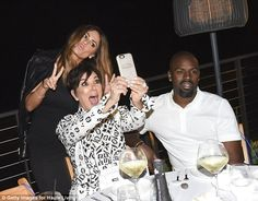 One for the photo album? Kris looked exuberant as she posed for a silly selfie with family friend Carla DiBello
