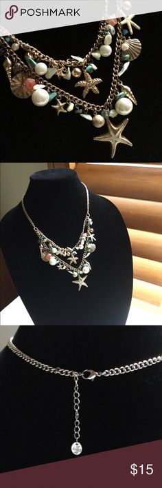 "Sea Shell Statement Necklace Beauty and the Beach! Here is a fun statement necklace done in a gold tone chain featuring fun, colorful stones, beads, and charms. Closes with a lobster clasp. 18"" with a 2"" extender. Drop for second chain and main charm is 3 1/4"". Jewelry Necklaces"