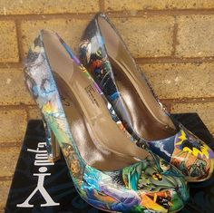 Batman heels.... Yes Please!! And they even have purple in them to tie in with the wedding colors :D