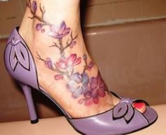 A Very Beautiful Flowers Vine Tattoos On Foot