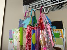 Hang gift bags from carabiners in the closet & Brilliant gift bag storage! I knew someone out there would have ...