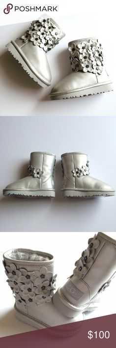 New in Box Toddler UGGs Adorable floral detailed UGGs in a shimmery silver! These are new in the box. Never worn. Box is included in purchase (lid is missing from box however). These are so cute and ALL girl! UGG Shoes Boots