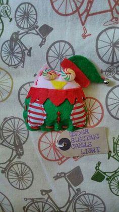 Christmas elf leftover Larry owl, www.Facebook.com/underelectriccandlelight