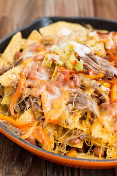 "These pork nachos that covered themselves in something called ""pina colada sauce"":"