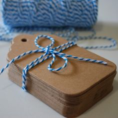 brown paper tags for table numbers, tied around glass jar.