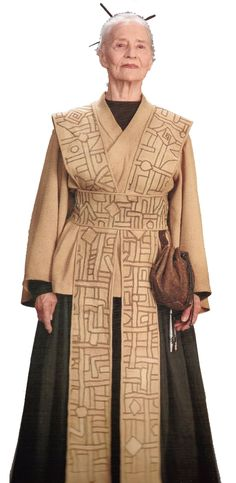 #MidweekPedia  JOCASTA NU / Chief Librarian  DESCRIPTION: was a female Human who served as the Chief Librarian of the Jedi Archives during the final days of the Galactic Republic, with a penchant for being a bit overconfident in the completeness of her Archives. Her patterned robes bore the symbols of the Ansata, representing her devotion to knowledge and learning. Military Survival Gear, Tactical Survival, Librarian Costume, Female Jedi, Jedi Outfit, Jedi Costume, Galactic Republic, Riding Pants, Star Wars Costumes