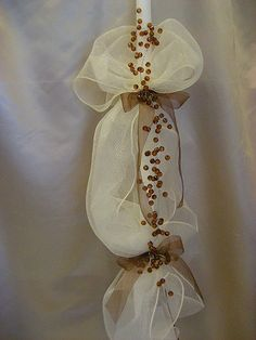 Ivory net twisted with brown beads and brown organza ribbon.