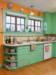 The use of period colors is evident in the kitchen of the restored 1906 bungalow. love the big windows and the curved end shelf!