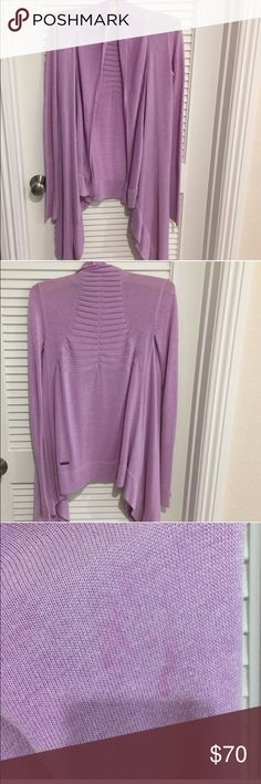 Lululemon purple open front cardigan Lululemon lavender open front cardigan. I'm not sure of the name of this sweater. Beautiful color! Small discoloration on sleeve as shown in third photo. lululemon athletica Tops