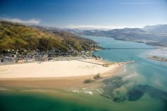 Barmouth, Wales. It's got it all - the clearest British sea I've ever seen, wide sandy beaches, mountains, rivers, the lot. I may live there one day :)