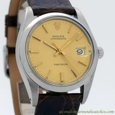1972 Vintage Rolex Oysterdate Ref. 6694 Manual Wind Stainless Steel watch with Original Gold/Champagne Dial with Applied Gold Color Stick/Bar/Baton Markers. Tripe Signed. Case Excellent Condition Case