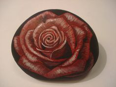 Red Rose hand painted on a rock by wildstonepainter on Etsy, $20.00