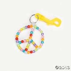 Peace Sign craft out of beads and pipe cleaners. Perfect for Charly's peace sign bday party.