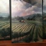 This mural of an oregon wine country landscape was painted on 3 plywood panels and hung in a basement wine cellar to cover a cinderblock wall. The mural was painted by Mural Mural On The Wall based out of Eugene Oregon.