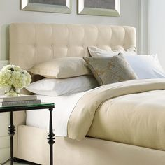 bernhardt interiors. maxime platform wing bed with tufted
