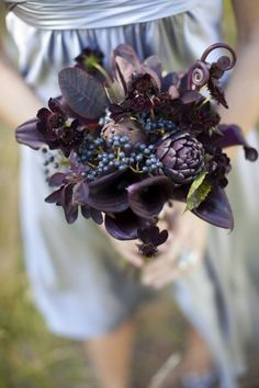 Awesome bouquets ideas. Artichokes, midnight calla lillies, thistles, crow feathers, and suculents.
