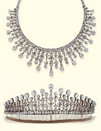 AN ANTIQUE DIAMOND NECKLACE/TIARA   Designed as a graduated fringe of pear-shaped diamonds suspended from knife-edge surmounts of foliate design with diamond collet detail to the old-cut diamond line neckchain, with tiara fittings and screwdriver, mounted in silver and gold, circa 1890, , in velvet fitted case  Signed S. Cartier, No. 840, tiara frame also signed S. Cartier