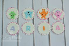 This listing includes 12 Monster Themed Cupcake Toppers. In the picture the white frosting cupcake is a mini cupcake and the grey frosting is a