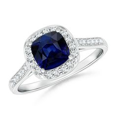 Romantic sapphire ring. This Cushion cut blue sapphire halo engagement ring by angara will surely make her girlfriends jealous.