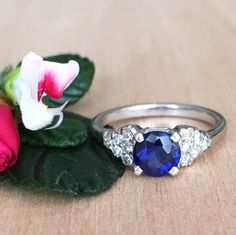Vintage Sapphire Engagement Ring, Round Sapphire Approx 1.00ct,12 side diamonds Approx 0.18ctw, 14kt white gold, size 6 by RedGingerJewelryCo on Etsy https://www.etsy.com/listing/215560085/vintage-sapphire-engagement-ring-round