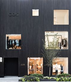 Fashion brand COS has opened its first Canadian store, concealing a minimal-looking interior behind a blackened cedar facade.