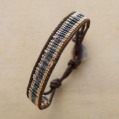 """BLUE STREAK BRACELET--Hand loomed glass seed beads—blue, silvery, golden—in a leather-bound wrap bracelet that pulls together a look quickly. Sterling silver button. USA. Exclusive. Fits 7"""" to 7-1/2"""" wrists."""