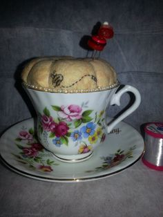 Pincushion in a vintage Royal Stanley cup and saucer  https://www.etsy.com/listing/167971266/pincushion-in-a-vintage-royal-stanley