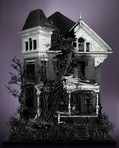Mike Doyle  Three Story Victorian with Tree  5' x 3' x 2'  50k - 60k pieces  Black, white, dark and bluish gray, clear trans and black trans colors used.  No foreign materials (wood, glue, paint or otherwise) were used – this is pure Lego.  Approx 450 hours to build