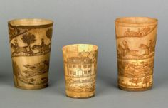 Group of three early, engraved horn cups. google.com