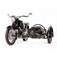 Vintage BMWs and sidecars go together like fish and chips. This beautiful rig comes from South African BMW specialists Cytech, and pairs an R69S with a genuine 1950s Steib chair.