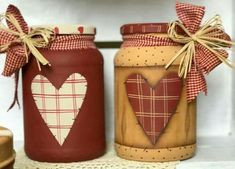 Country plaid hearts, raffia and checked bows adorn these primitive painted jars. Mason Jar Projects, Mason Jar Crafts, Mason Jar Diy, Bottle Painting, Bottle Art, Tin Can Crafts, Diy And Crafts, Primitive Crafts, Country Primitive