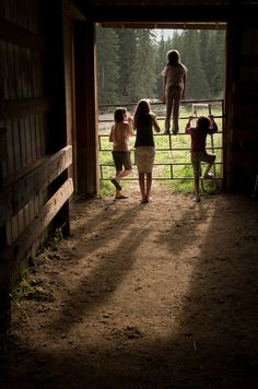 In the barn with kids facing away but turning and talking to one another....just the kids.