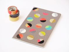 Upgrade your favorite notebook or journal with colorful, patterned washi tape dots. Get the tutorial at Moments To Live For.   - CountryLiving.com