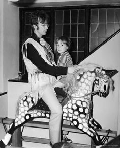 John Lennon and son Julian go for a ride on young Julian's giant rocking horse.❤️🌈💋😁🌸🌹