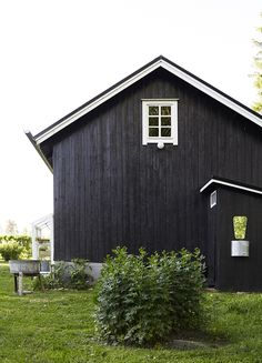 black with white windows and fascia . board and batt siding Black House Exterior, Interior And Exterior, Summer Cabins, Dark House, Cabins And Cottages, Cozy Cottage, Beautiful Buildings, House Colors, Future House