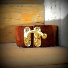 Great Leather Cuff Bracelet!  Two-Tone, With Swing Latch Closure    $24.95, via Etsy.