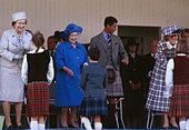 Queen Elizabeth 11 September 1989 presenting prizes at the Braemar Highland games with Queen Mother Prince Charles - Stock Photo