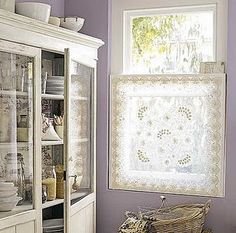 lace curtain + glass cabinet