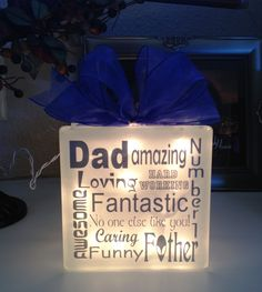 My husband's Father's Day present.  I had both of the boys come up with five words or phrases that they felt described dad and I put it together into a lighted glass block design.  He loves it.  <3 facebook.com/canvasvinyldecor