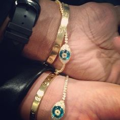 Lorraine Schwartz Evil eye bracelet paired with Cartier love bracelet.