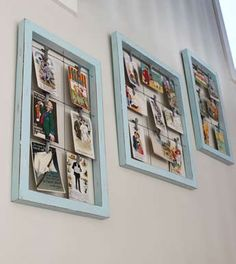 Vintage postcards are hung  on clips within an open frame so  that you can flip them over to read  the messages on the back.