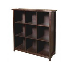 $278.99 Whether it's books or display items, the Acadian 9 Cube Storage Bookcase lets you keep things looking good and organized in any room. This piece is crafted from plantation-grown pine and given a tobacco brown finish. Its multiple square storage cubbies make the perfect platform for showcasing your books and collectables.