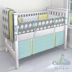 Crib bedding in White and Gray Polka Dot, Yellow Minky, Gray and White Elephants, Aqua Herringbone, Natural Minky Chenille, Solid Banana, White and Gray Elephants. Created using the Nursery Designer® by Carousel Designs where you mix and match from hundreds of fabrics to create your own unique baby bedding. #carouseldesigns