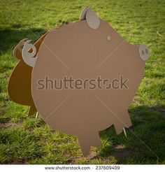 Creative decorations of cardboard  in park. Pig