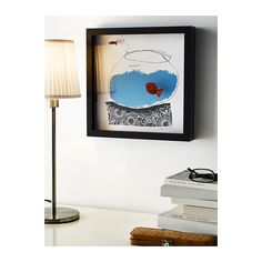 Your child's work inside the frame.  OLUNDA Picture IKEA Motif created by Jane Ormes. The fish are mounted at a distance from the background, which gives the picture added depth....  http://www.ikea.com/us/en/catalog/products/90221912/