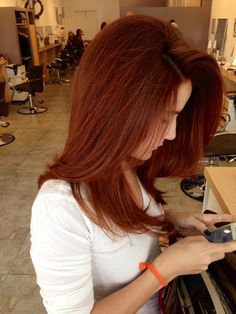 Deep ,rich Copper tone on Yaya at Gleam Hair Studio Miami. Color and cut by Tish.